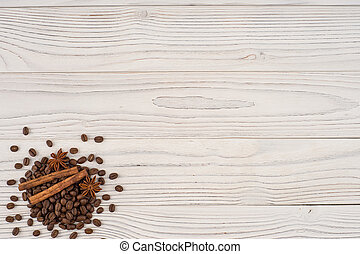 Coffee with cinnamon on old wooden table. Top view.