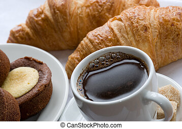 Black coffee with croissants and cookies