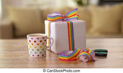 coffee with gift and gay pride awareness ribbon - homosexual...