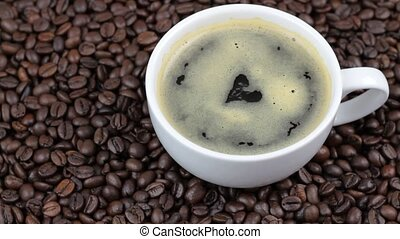 Coffee with heart shape on coffee beans. 1920x1080p HD video