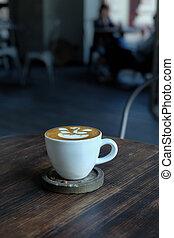 Coffee with milk foam art pattern