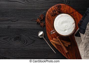 Coffee with milk on dark wooden background top view