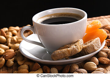 Coffee with nuts, fig and dried apricots