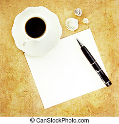 Coffee with Pen and Blank Paper