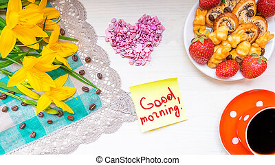 Coffee with sweets - pretzels with poppy seeds, fresh red strawberries and the inscription in the notebook: Good morning, my Love. The concept of Breakfast for Valentine's Day, love