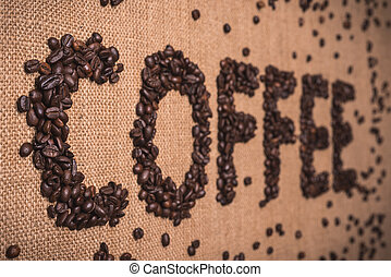 coffee word with coffee beans
