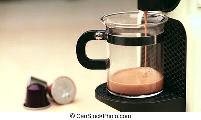 Coffeemaker brewing espresso coffee - Single-serving coffee...