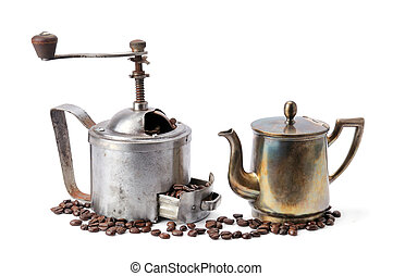 Coffeepot, coffee- grinder and coffee grains isolated on white background.
