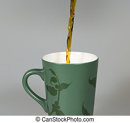 Coffey Pouring in to Cup close up image.