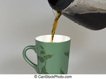 Coffey Pouring in to Cup close up.