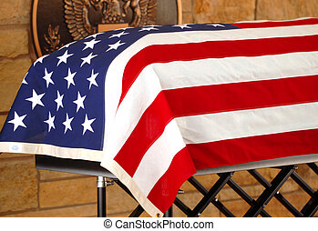 Coffin draped with the American Flag - The coffin of a...