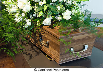 Coffin in morgue - A coffin in a morgue with a flower...