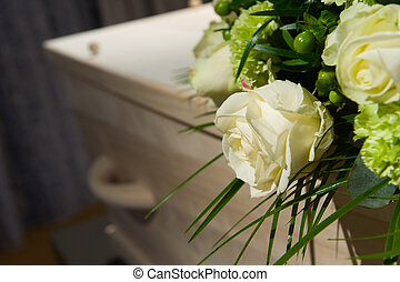 Coffin in morque - A coffin with a flower arrangement in a...