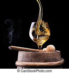 Cognac and Cigar on black with vintage barrel