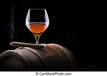 Cognac and Cigar on black with vintage barrel - Cognac and...