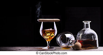 Cognac and Cigar on black with vintage table