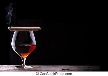 Cognac and Cigar on black with vintage table - Cognac and...