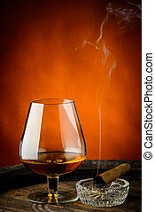 Cognac and cigar - still life with glass of cognac and cigar...