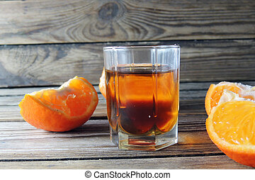 cognac and orange - Cognac in glass and Orange on wooden...