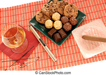 cognac, cigar and sweets