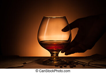 Glass of cognac with old love letters