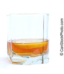 Cognac in a glass, with lemon
