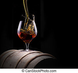 Cognac or brandy on a black - Cognac or brandy on a black...