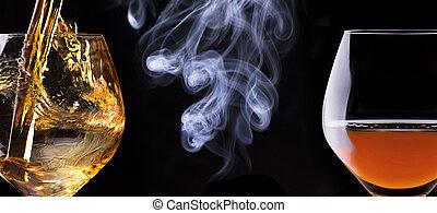Cognac or brandy on a black with cigar smoke