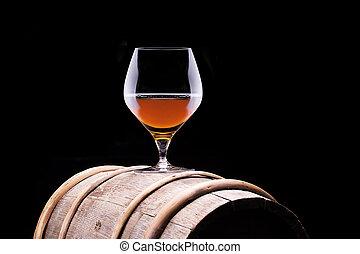 Cognac or brandy on a wooden barrel