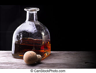Cognac or brandy on a wooden table - Cognac or brandy on a...