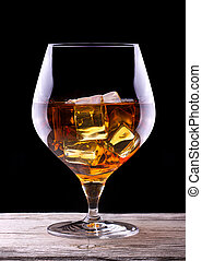Cognac or brandy on a wooden table