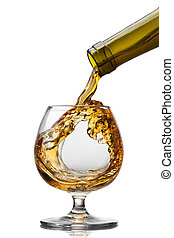Cognac pouring into glass with splash isolated on white...