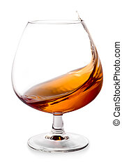 Cognac splashes in a glass - The glass with splashes brandy