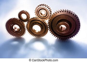 Cogs - Closeup of five steel cogs
