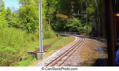 Cogwheel Train in Mountains. Train in Steep Mountains Driving Uphill. Switzerland, Montreux, Rochers-de-Naye.