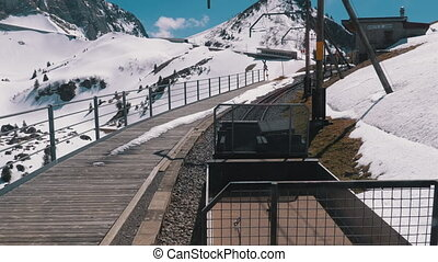 Cogwheel Train Rides in the Snowy Mountains on the Railway. Switzerland, Alps