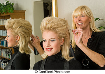 coiffeur - a beautiful young woman gets a new hairstyling