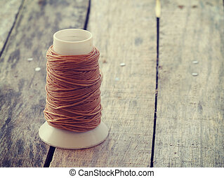coil of coarse  rope on wood old retro vintage style