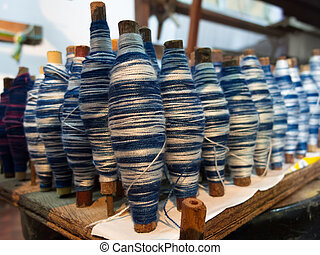 Coil of blue and white thread for weaving in local Thai area.