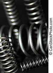 Coil spring - Metal coil springs on black background