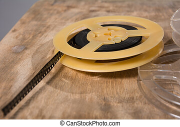 Coil with 8 mm of film lies on a wooden surface