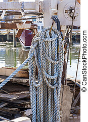 Coiled line on docked fishing boat