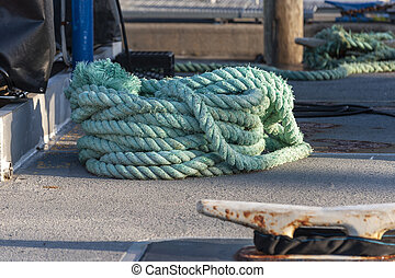 Coiled line sitting on wharf