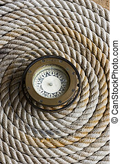 Rope coil with antique compass in the center