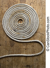 Rope coil on an antique chest