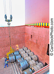 Coiled steel sheets in a ship