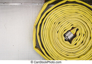 Coiled Yellow Fire Hose and Chrome