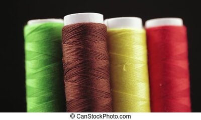 Coils with threads - Multicolored coils with sewing thread
