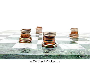 coin chess pieces on the board, on white