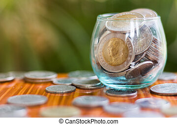 Coin in glass bottle with money stack step up growing growth saving money, Concept financial business investment.